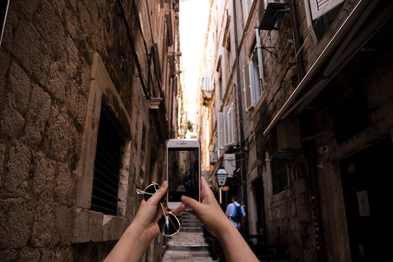 Lauren taking a photo in Dubrovnik